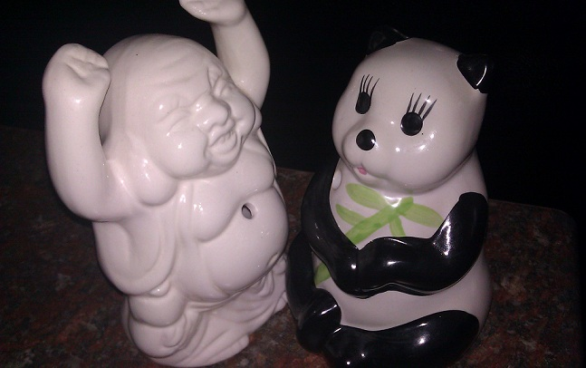 porcelain panda and Budda